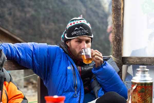 guy drinking tea at the everest basecamp
