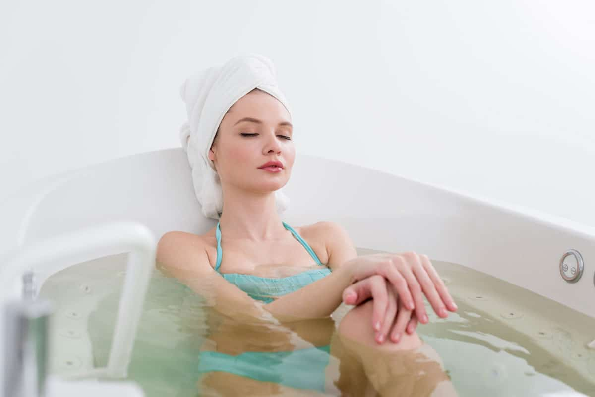 Hydrotherapy - Woman having a bath in home